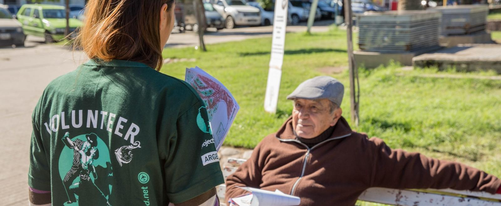 A student speaks to a local man during a campaign on her Human Rights internship in Argentina.